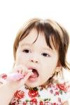 Infant cleans teeth